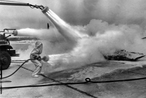 Feb. 16, 1947: Navy firefighters use carbon-dioxide vapor spray to snuff out a fire in a plane during an exhibition at the Glenview Naval Air Station.