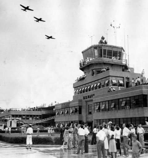 July 1, 1946: A crowd of 45,000 attended an open house at the Glenview Naval Air Station. Here, spectators watch a flight of fighters from the operations tower and the main hangar.