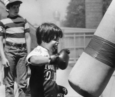 Aug. 15, 1977: Tommie Hooper, 6, works out with a punching bag at Rugen School as part of the school's physical education pilot program.