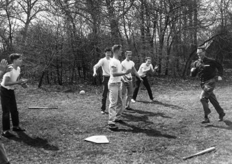 April 23, 1957: The Rev. Ritchie takes part in a ball game during a sports break scheduled as part of a religious weekend for sophomores from Glenview.