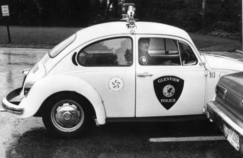 Aug. 4, 1978: Glenview policeman Robert Helton uses a VW Beetle -- with the steering wheel on the right side -- to issue traffic tickets.
