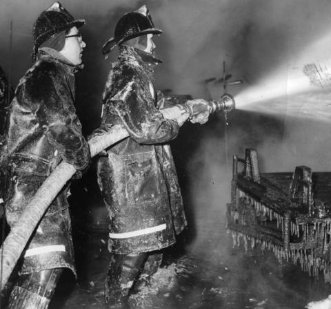 Jan. 26, 1963: Ice forms on firefighters' clothes as they battle a blaze at a fence factory located at 1876 Grove St.
