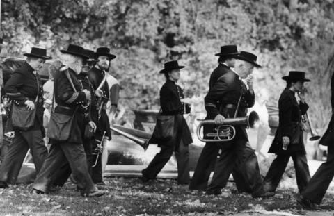 Oct. 2, 1983: Members of the First Brigade Civil War Band of Milwaukee carry Civil War-era instruments across a field as they prepare for a concert at Grove Fest.