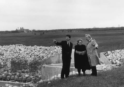 April 22, 1992: William Berndy (left), project manager for Marathon U.S. Realties Inc., looks over the Techny site with Elise Couston and E.A. Barnett of Paine/Wetzel Associates Inc., which is marketing the new housing development. Techny Towers is visible in the distance.