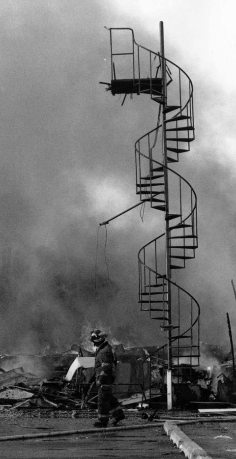 March 13, 1992: A stairway is all that remains of a recreational facility destroyed by a fire at the Glenview Naval Air Station. No one was injured, and the fire's cause was unknown. Damage was estimated at $10 million.