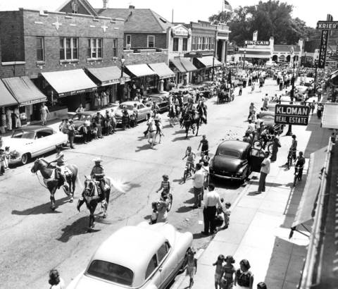 Aug. 4, 1952: The Skokie Rodeo Parade marches through Skokie's business district. Horses and riders were followed by children dressed in Western attire.
