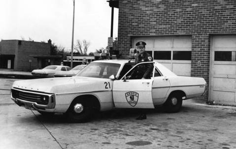 Nov. 11, 1971: Patrol officer Robert Grau poses for a photo by his Skokie squad car.