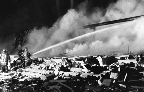 March 3, 1976: Firefighters keep a heavy stream of water on the remains of the warehouse of Sounds Unlimited, 7440 Niles Center Road. The building was destroyed by an explosion and fire, killing one person.