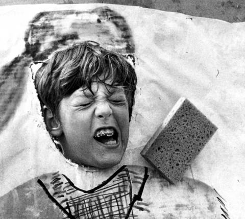 Aug. 6, 1973: A boy participating in the Skokie Park District community parade and carnival at Oakton Park is whacked in the face with wet sponges. Games of all sorts were offered by youngsters at the carnival, part of the district's summer program.