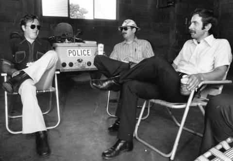 "July 7, 1975: Members of the Skokie Police Department show up for work in street clothes to protest the village's ""disrespect of their uniforms"" because of an unsatisfactory pay agreement."
