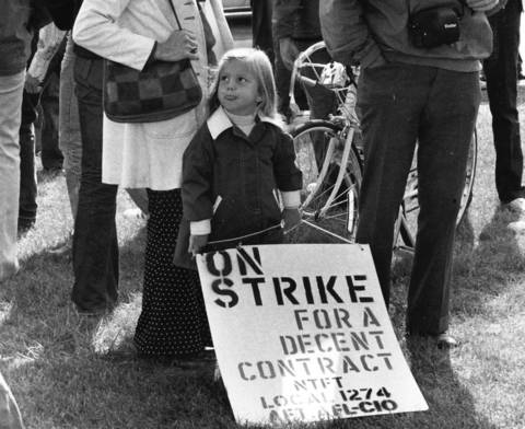 Sept. 28, 1976: A youngster holds one of the picket signs outside Niles North High School in Skokie as a teacher strike entered its fifth day.