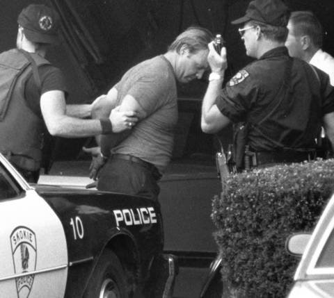 Aug. 24, 1985: A robbery suspect is handcuffed and taken into custody after surrendering at a Skokie home.