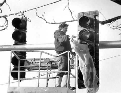 Dec. 14, 1989: John Eccardt of Wood Electrical uncovers the new traffic control lights at Touhy Avenue and Niles Center Road in Skokie.