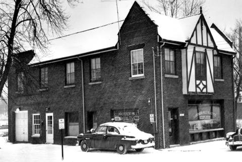 March 15, 1953: Purchased for $46,000, this building housed the police department in the rear. The police chief lived in the apartment over the station. When the realty company's lease expired, the fire department was set to move into the front half of the structure.