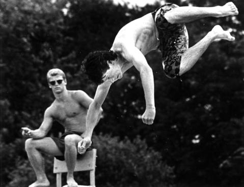 June 17, 1987: A lifeguard observes a diver attempting the difficult full-throttle lunge off the boarad at Kubat Pool at Lions Park in Clarendon Hills.