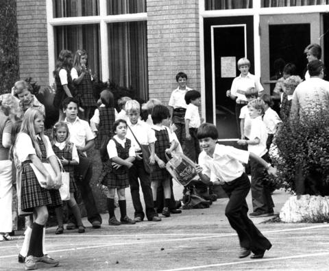 Aug. 30, 1977: Among the first children to begin the new school year were pupils at Notre Dame School in Clarendon Hills. Throughout the week, various primary and secondary schools in Cook and DuPage suburbs opened their doors -- a source of irritation for some parents because the openings precede the long Labor Day weekend.
