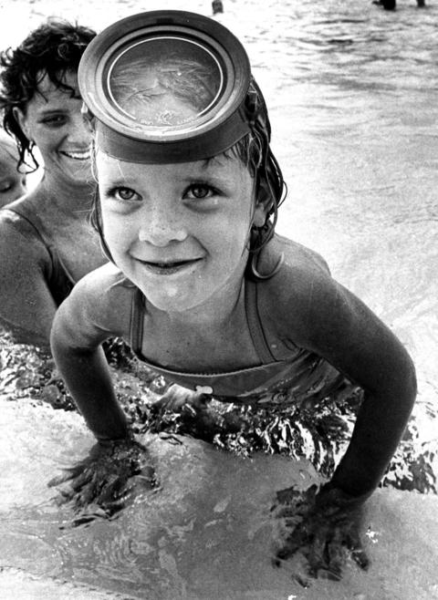 June 17, 1987: Sandy Garreson, 5, emerges from the waters of Kubat Pool while swimming with her mother, Judy.