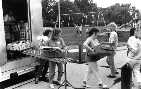 Sept. 22, 1988: PTA members at Walker Elementary School in Clarendon Hills unload a truck for Market Day.