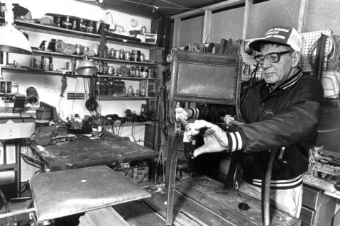 Feb. 3, 1990: James Mineo, who is retired, helps his Park Avenue neighbors by doing repair jobs in his garage workshop in Clarendon Hills. He is putting a clamp on a chair that became unglued.