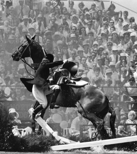 Aug. 7 1969: A rider and her horse fail to clear a jump at the Grand Prix International Jumping Competition at the Oak Brook Polo Club.
