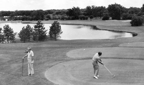 June 19, 1974: A golfer takes a swing on the 14th hole at Butler National Golf Club in Oak Brook.