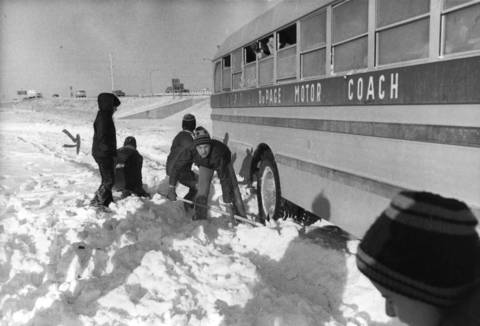 Feb. 4, 1972: Students try in vain to extricate a school bus that got stuck on Hamilton Lane near Kingston Drive in Oak Brook.