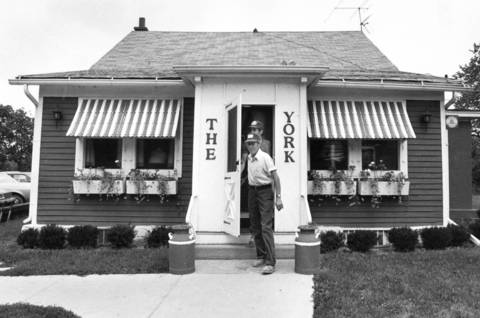 Aug. 29, 1985: Patrons exit the York Tavern on York Road near Salt Creek.