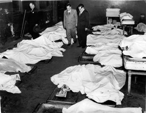 Police officers and the coroner at the county morgue on May 25, 1950. The tragic accident left 34 persons dead.