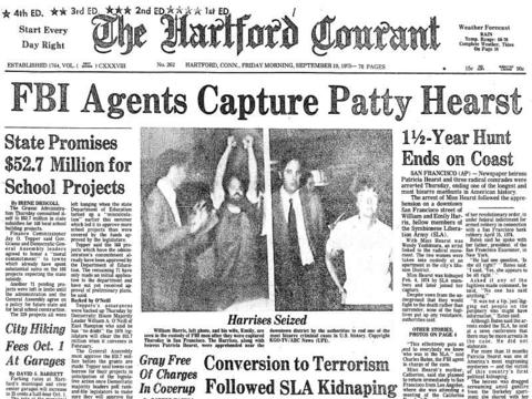 Newspaper heiress Patty Hearst was kidnapped by the Symbionese Liberation Army, an American left-wing revolutionary group. in Feb 1974. Hearst proceeded to join her captors and was arrested for armed robbery on Sept. 18, 1975. She claimed she was brainwashed by the SLA, but was convicted anyway and sentenced to seven years in prison. President Carter commuted her sentence and she was released in early 1979.
