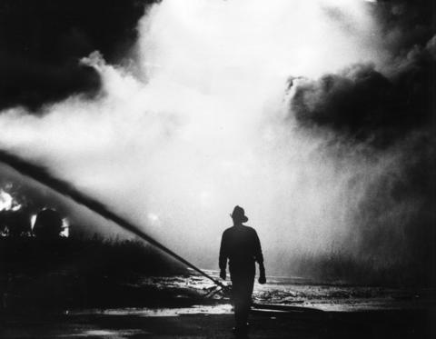 Oct. 23, 1967: A fireman walks toward a fire at the Penray Chemical Co., at 1801 Estes Rd. in Elk Grove Village.