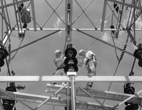 July 13, 1967: Commonwealth Edison crewmen are perched on a switching structure at Tonne Road and Devon Avenue in Elk Grove Village. The structure is part of a $400,000 project to install two 33,000 kilowatt transformers to serve 60,000 customers in the area around Elk Grove Village.