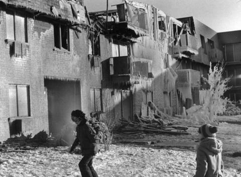 Jan. 17, 1972: Children play outside ice-covered ruins of the Terrace Apartment Building, 912 Ridge Square in Elk Grove Village, where a fire sent more than 100 people fleeing into the cold night.