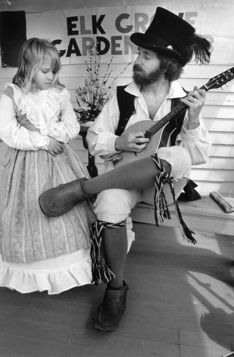 May 10, 1992: Jennifer Nordmeyer listens to Clifford Long play the mandolin at the Elk Grove Historical Society's Spring Planting Festival.