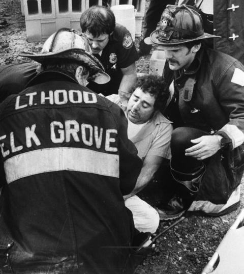 Sept. 5, 1980: Firefighters come to the aid of a worker injured when a 20-by-75-foot wall collapsed at an industrial building under construction in Elk Grove Village. Seven other workers were injured, one seriously, when a wind gust apparently pushed the wall onto the scaffold on which they were working.