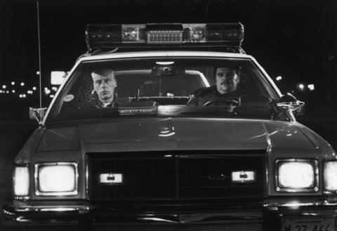 """Oct. 18, 1983: Jack Jones accompanies Elk Grove Village police officer Stephen Schmidt in the department's """"ride-along"""" program."""