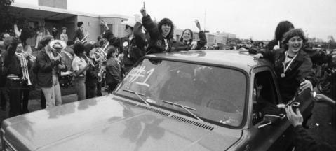 March 30, 1981: Exuberant Grenadiers accept homage from Elk Grove fans during a triumphant ride through the village after their return from Champaign with the Class AA title.