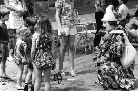 "June 22, 1973: A clown entertains youngsters with the classic ""invisible dog"" trick at the Midlothian Highland Games Weeks parade."