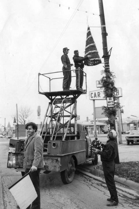 Dec. 8, 1971: Midlothian Public Works employees giving a Yuletide look to village streets string Christmas decorations on a light pole at 147th Street and Crawford Avenue.