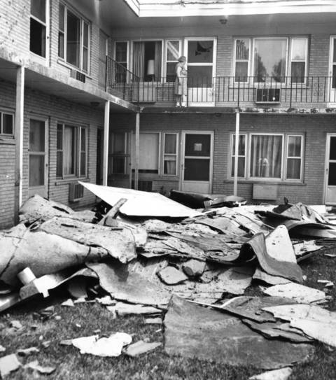 July 13, 1966: Roofing was torn off an apartment building at 14517 Crawford Ave. in Midlothian after a storm caused extensive damage to the area.