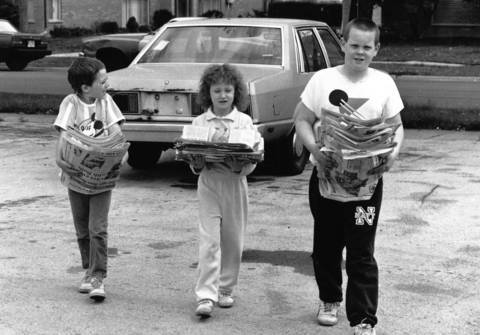 May 14, 1989: (From left) Patrick Shaughnessy, 6; Pam Rea, 6; and her brother Jim, 11, bring their donations for paper drive to St. Christopher's Catholic Church in Midlothian.