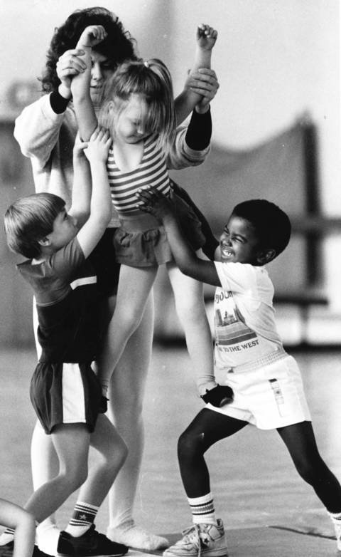 Oct. 18, 1988: Dusty Frelka (center), Scott Klein (left) and Roger Elion get help from Debi Greenberg, an acrobatics instructor, as they try to form a pyramid at the Midlothian Community Center.