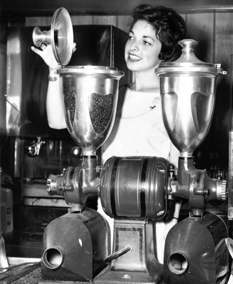 Aug. 9, 1963: Tony Caliento shows off her old-fashioned coffee grinder. Many Barrington merchants used the village's centennial to display antique items.