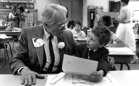 "May 15, 1988: Theophilus ""Ted"" Nachowitz, 75, sits with his grandson, Doug Nachowitz, 8, in Doug's second grade classroom during Grandparent's Day at Walker Elementary School in Clarendon Hills. The tag on the elder Nachowitz's lapel reads, ""I belong to Doug N. Grandpa Ted."""