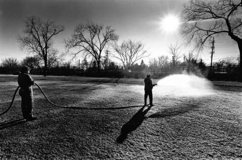 Dec. 12, 1986: Hinsdale Park District employees Mark Wagner, right, and Chris Werner spray a section of Stough Park. It was an attempt to create a makeshift rink for ice skating.