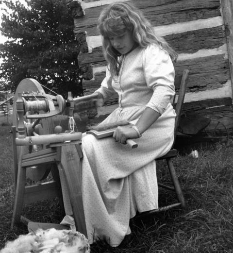 Sept. 24, 1989: Shana Eaton, 12, of Naperville, spins wool at Naper Settlement.