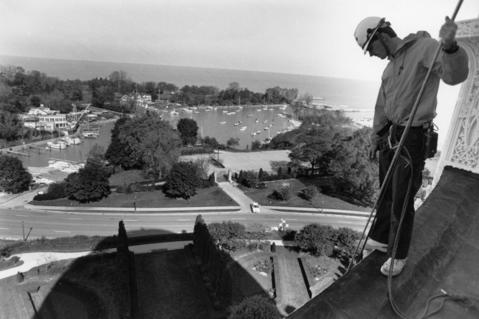 Oct. 24, 1990: Dave Hadden, project supervisor, looks over the edge and talks to two men working along the side of Baha'i House of Worship in Wilmette.