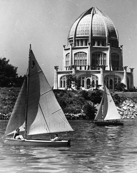 Undated: Boaters soak up the sun in Wilmette with Baha'i Temple in view.