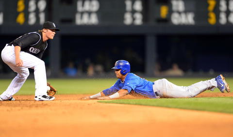 Welington Castillo slides to steal second base against Rockies shortstop Josh Rutledge in the sixth inning at Coors Field.