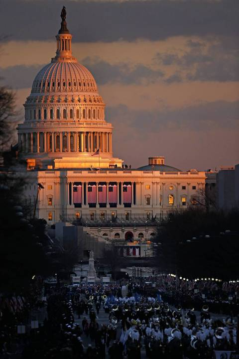 The sun sets on the U.S. Capitol during the inauguration parade of President Barack Obama along Pennsylvania Avenue in Washington, D.C.