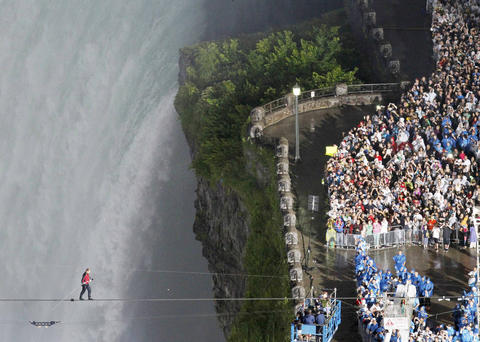 Tightrope walker Nik Wallenda walks the high wire from the U.S. side to the Canadian side over the Horseshoe Falls in Niagara Falls, Ontario, on June 15, 2012.